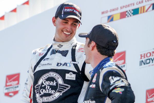 31 July - 2 August, 2015, Lexington, Ohio USA Graham Rahal talks to Simon Pagenaud on the podium ?2015, Sam Cobb LAT Photo USA
