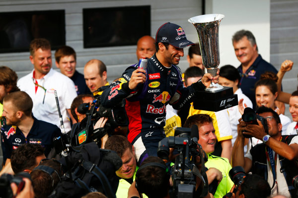 Hungaroring, Budapest, Hungary. Sunday 27 July 2014. Daniel Ricciardo, Red Bull Racing, 1st Position, and the Red Bull team celebrate victory. World Copyright: Andy Hone/LAT Photographic. ref: Digital Image _ONY2950