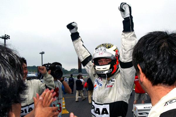 2004 Formula Nippon ChampionshipMotegi, Japan. 6th June 2004.Race winner, Andre Lotterer (PIAA Nakajima), celebrates.World Copyright: Yasushi Ishihara/LAT Photographicref: Digital Image Only