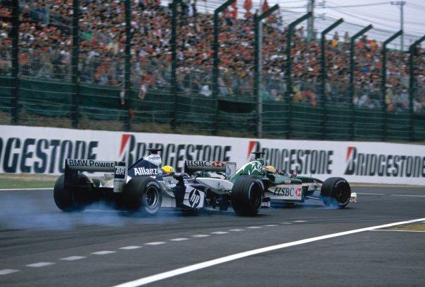 2003 Japanese Grand PrixSuzuka, Japan. 10th - 112th October 2003.Ralf Schumacher, BMW Williams FW25, Mark Webber, Jaguar R4, action.World Copyright: Steven Tee / LAT Photographic ref: 35mm Image 03JAP22