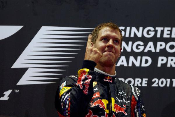 Marina Bay Circuit, Singapore.25th September 2011.Sebastian Vettel, Red Bull Racing RB7 Renault, 1st position, celebrates. Portrait. Podium. World Copyright:Glenn Dunbar/LAT Photographicref: Digital Image _G7C8265