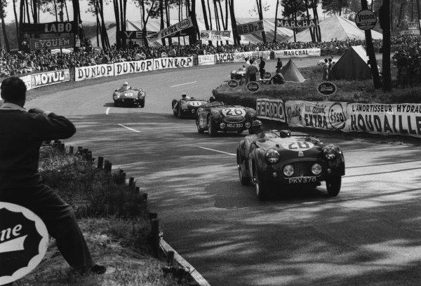 Le Mans, France. 11th - 12th June 1955.Robert Dickson/Ninian Sanderson (Triumph TR2), 14th position, leads Lance Macklin/Les Leston (Austin-Healey 100S), retired, action. World Copyright: LAT Photographic.Ref: B/W Print.