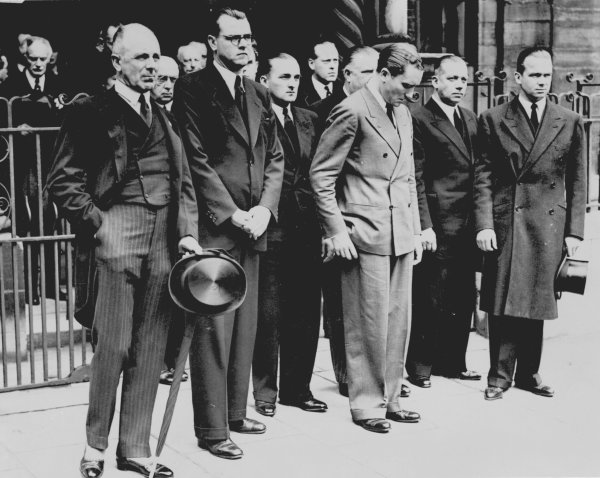 7 July 1939.Mourners line up after the service, left-to-right: Lord Howe, Rudolf Hasse, Hermann Lang, Manfred von Brauchitsch, Alfred Neubauer (hidden), unknown, and Rudolf Caracciola.Published-Autocar 7/7/1939 p36.World Copyright - LAT Photographic