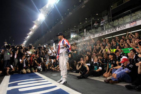 Yas Marina Circuit, Abu Dhabi, United Arab Emirates. Sunday 23 November 2014. Lewis Hamilton, Mercedes AMG, 1st Position, celebrates 2014 Championship victory with his team. World Copyright: Andrew Ferraro/LAT Photographic. ref: Digital Image _MG_1552