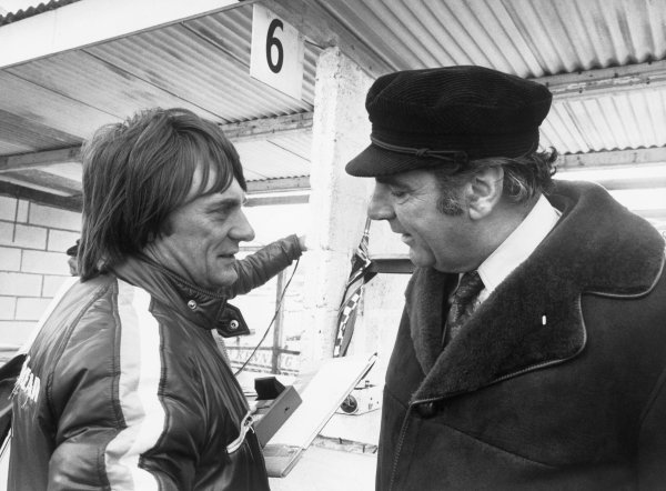 Brands Hatch, England. 17th March 1974.Brabham owner, Bernie Ecclestone in converstion with John Cooper, portrait.World Copyright: LAT Photographic.Ref: L74 - 318/29-29A