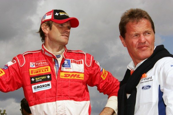L-R: Marcus Gronholm (FIN), Peugeot, and Malcolm Wilson (GBR), director of MSport - discussing 2006 maybe? FIA World Rally Championship, Rd11, Rallye Deutschland, Trier, Germany. Day Two, 27 August 2005. DIGITAL IMAGE