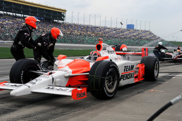 Helio Castroneves (BRA), Team Penske, makes a pit stop.