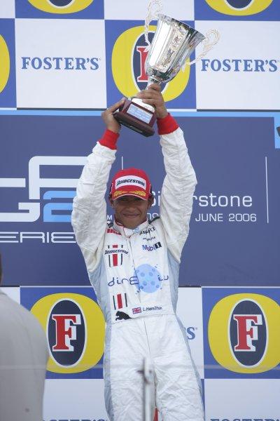 2006 GP2 Series Round 6. Silverstone, England. 11th June 2006. Sunday race. Lewis Hamilton (GBR, ART Grand Prix) race winner. Podium.World Copyright: Andrew Ferraro/GP2 Series Media Service. Ref: Digital Image Only ZP9O7933