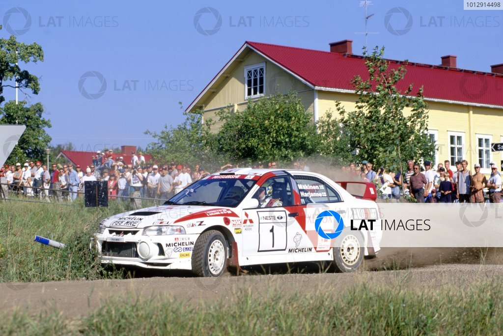 1997 World Rally Championship.1000 Lakes Rally, Finland. 29-31 August 1997.Tommi Makinen/Seppo Harjanne (Mitsubishi Lancer Evo4), 1st position.World Copyright: LAT PhotographicRef: 35mm transparency 97RALLY12