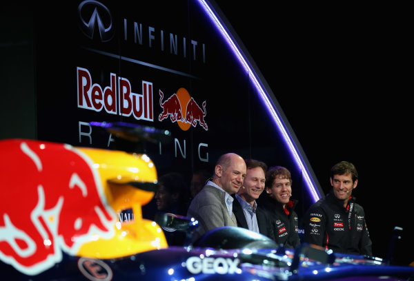 Milton Keynes, UK 3rd February 2013 .(L-R) Adrian Newey, Chief Technical Officer, Christian Horner, Team Principle, Mark Webber of Australia, and Sebastian Vettel of Germany talk to the guests Photo: Mark Thompson/Getty Images/Red Bull Racing () ref: Digital Image 160597653_10