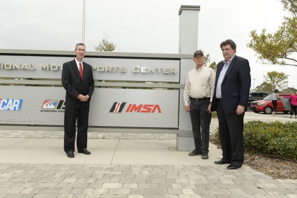19-20 November, 2013, Daytona Beach, Florida Jim France, Ed Bennett, and Mike Helton unveil the new IMSA sign at International Motorsports Center in Daytona Beach, FL @2013 Richard Dole LAT Photo USA