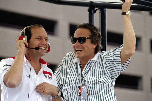 Ron Dennis and Mansour Ojjeh of McLaren share a joke on the pitwall.