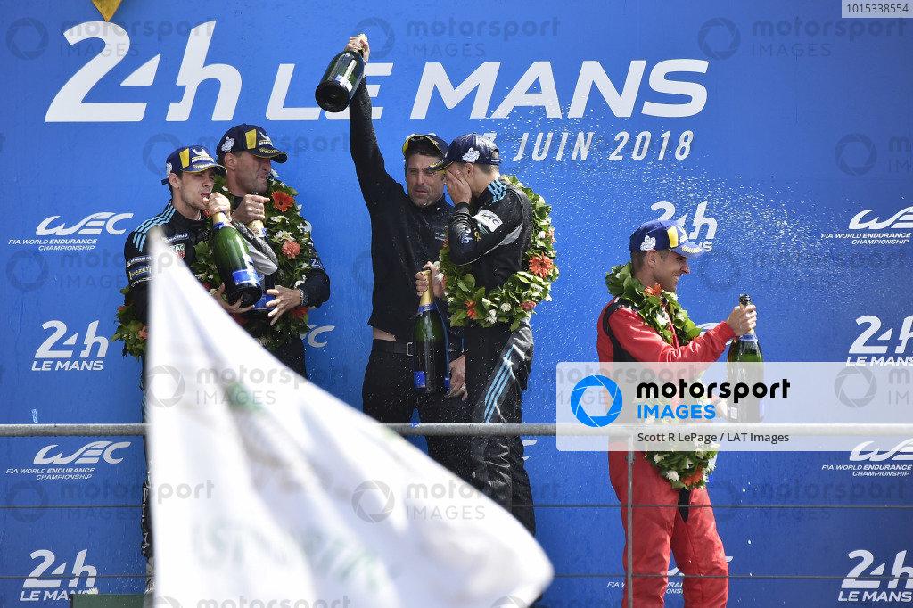 #77 Proton Competition Porsche 911 RSR: Christian Ried, Julien Andlauer, Matt Campbell celebrate on the podium