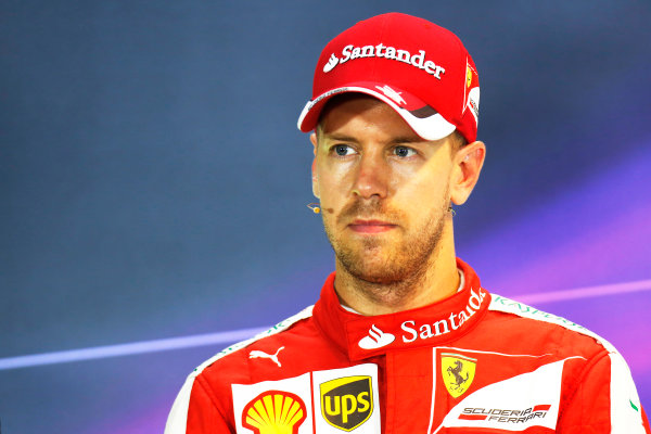 Marina Bay Circuit, Singapore. Saturday 19 September 2015. Pole man Sebastian Vettel, Ferrari, in the post Qualifying Press Conference. World Copyright: Alastair Staley/LAT Photographic ref: Digital Image _79P2311