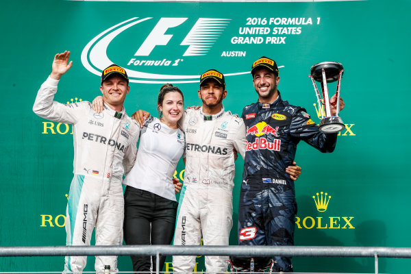 Circuit of the Americas, Austin Texas, USA. Sunday 23 October 2016. Nico Rosberg, Mercedes AMG, 2nd Position, Victoria Vowles, Partner Services Director, Mercedes AMG, Lewis Hamilton, Mercedes AMG, 1st Position, and Daniel Ricciardo, Red Bull Racing, 3rd Position, on the podium. World Copyright: Glenn Dunbar/LAT Photographic ref: Digital Image _31I5284