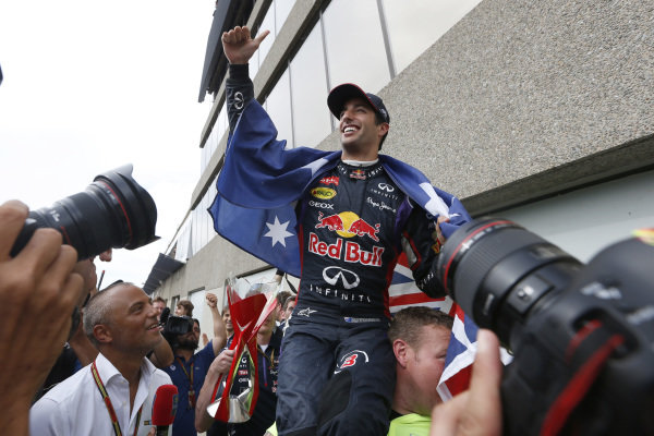 Circuit Gilles Villeneuve, Montreal, Canada. Sunday 8 June 2014. Daniel Ricciardo, Red Bull Racing, 1st Position, celebrates with his team. World Copyright: Alastair Staley/LAT Photographic. ref: Digital Image _79P1320