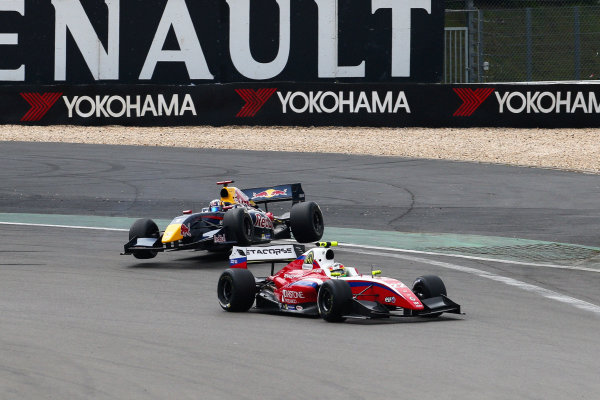 NURBURG (GER) JUL 11-13 2014 - World series by Renault 2014 at the Nurburgring. Carlos Sainz jr. #1 Dams, crashes out at the start, with the eventual race winner Roberto Merhi #22 Zeta Corse, in the foreground. Action. © 2014 Diederik van der Laan  / Dutch Photo Agency / LAT Photographic