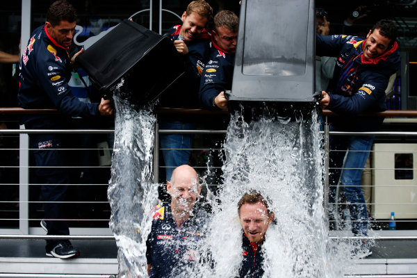 Spa-Francorchamps, Spa, Belgium. Saturday 23 August 2014. Sebastian Vettel, Red Bull Racing, and Daniel Ricciardo, Red Bull Racing, soak Adrian Newey, Chief Technical Officer, Red Bull Racing, and Christian Horner, Team Principal, Red Bull Racing, for the Ice Bucket Challenge. World Copyright: Charles Coates/LAT Photographic. ref: Digital Image _J5R1145