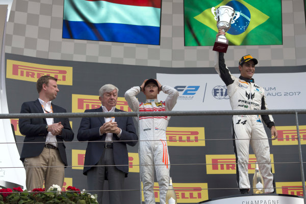 2017 FIA Formula 2 Round 8. Spa-Francorchamps, Spa, Belgium. Sunday 27 August 2017. Sergio Sette Camara (BRA, MP Motorsport) celebrates his victory on the podium with Nyck De Vries (NED, Racing Engineering) and Luca Ghiotto (ITA, RUSSIAN TIME).  Photo: Alastair Staley/FIA Formula 2. ref: Digital Image _L5R6039