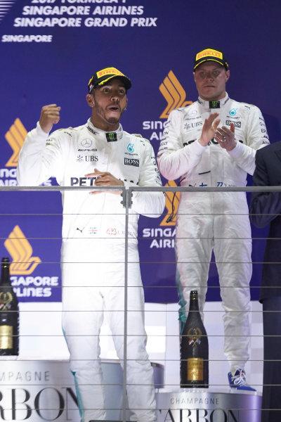 Marina Bay Circuit, Marina Bay, Singapore. Sunday 17 September 2017. Lewis Hamilton, Mercedes AMG, 1st Position, and Valtteri Bottas, Mercedes AMG, 3rd Position, on the podium. World Copyright: Steve Etherington/LAT Images  ref: Digital Image SNE17233