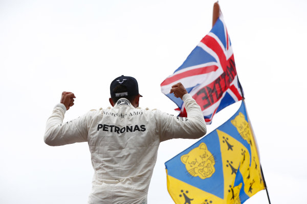 Silverstone, Northamptonshire, UK.  Sunday 16 July 2017. Lewis Hamilton, Mercedes AMG, 1st Position, celebrates with the crowd after the race. World Copyright: Hone/LAT Images  ref: Digital Image _ONY8249