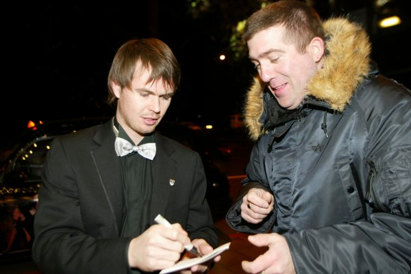 2003 AUTOSPORT AWARDS, The Grosvenor, London. 7th December 2003.BTCC driver, James Thompson stops to sign autographs on his way into the awards.Photo: Peter Spinney/LAT PhotographicRef: Digital Image only