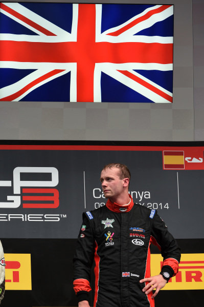 Race two winner Dean Stoneman (GBR) Marussia Manor Racing  celebrates on the podium. GP3 Series, Rd1, Barcelona, Spain, 9-11 May 2014.