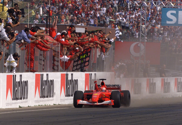 2001 Hungarian Grand PrixHungaroring, Hungary. 19th August 2001.Michael Schumacher, Ferrari F2001, takes his 4th Formula 1 World Championship, the constructors tiltle for Ferrari and equals Alain Prosts 51 carrer wins.World Copyright: Steve Etherington/LAT Photographic.ref: 13 5mb Digital Image Only