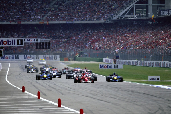 Michael Schumacher, Ferrari F2004 leads Fernando Alonso, Renault R24 and Kimi Räikkönen, McLaren MP4-19B Mercedes at the start.