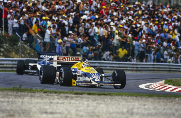 Nelson Piquet, Williams FW11 Honda, leads Derek Warwick, Brabham BT55 BMW.
