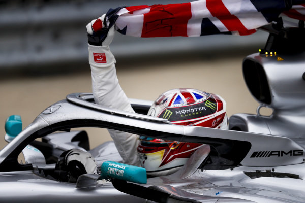 Race winner Lewis Hamilton, Mercedes AMG F1 W10on the cool down lap with a flag