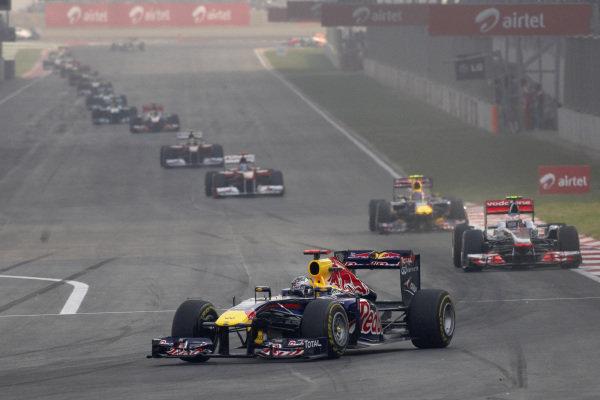 Sebastian Vettel, Red Bull RB7 Renault, leads Jenson Button, McLaren MP4-26 Mercedes, Mark Webber, Red Bull RB7 Renault, Fernando Alonso, Ferrari 150° Italia, and Felipe Massa, Ferrari 150° Italia.