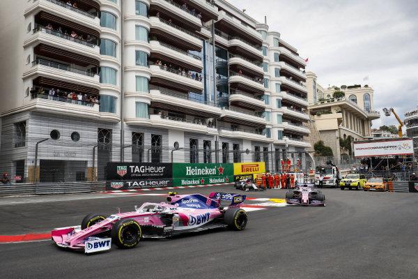 Lance Stroll, Racing Point RP19, leads Sergio Perez, Racing Point RP19, and Kimi Raikkonen, Alfa Romeo Racing C38