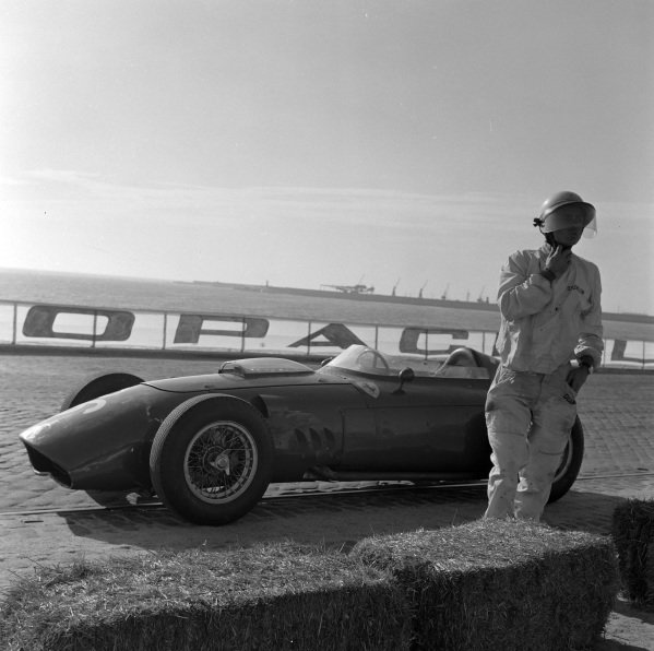 Phil Hill walks away from his Ferrari 246 after crashing on lap 29.