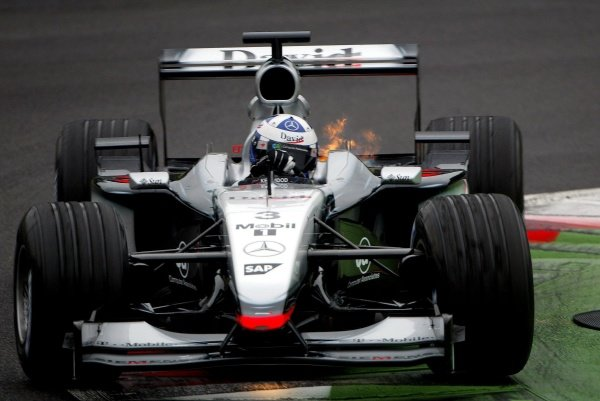 David Coulthard (GBR) McLaren MP4/17, spits flames as he enters the chicane.Formula One Testing, 3-6 September 2002, Monza , Italy.