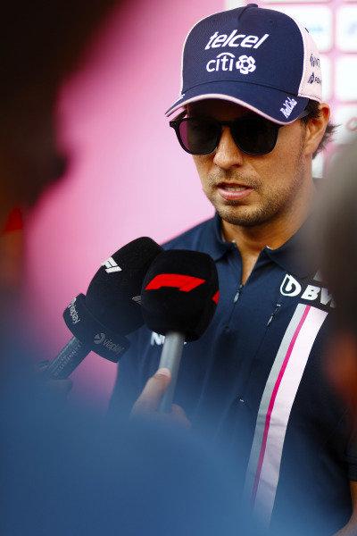 Sergio Perez, Force India, talks to the media.