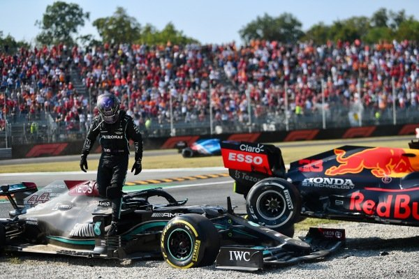 Sir Lewis Hamilton, Mercedes W12 and Max Verstappen, Red Bull Racing RB16B collide at the first chicane. Sir Lewis Hamilton, Mercedes, walks away from the scene of the accident