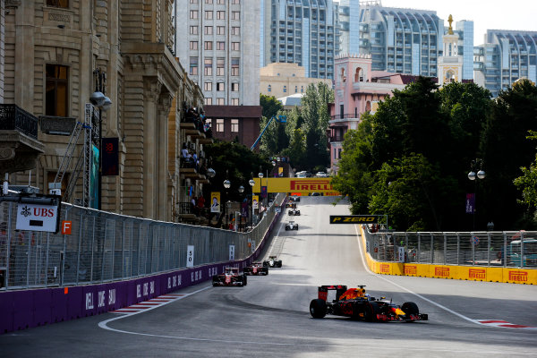 Baku City Circuit, Baku, Azerbaijan. Sunday 19 June 2016. Daniel Ricciardo, Red Bull Racing RB12 TAG Heuer leads Sebastian Vettel, Ferrari SF16-H at the start of the race World Copyright: Sam Bloxham/LAT Photographic ref: Digital Image _SLA3480