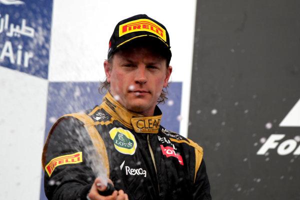 Bahrain International Circuit, Sakhir, Bahrain22nd April 2012Kimi Raikkonen, Lotus GP, 2nd position, sprays the Waard.World Copyright: Andy Hone/LAT Photographicref: Digital Image HONY8706