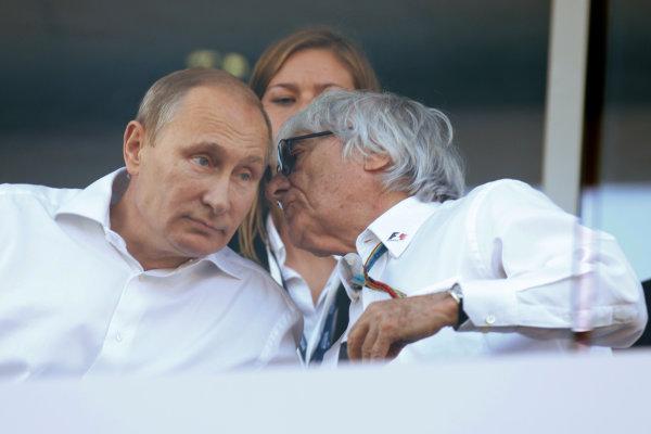 Sochi Autodrom, Sochi, Russia. Sunday 12 October 2014. Bernie Ecclestone talks with Russian President Vladimir Putin during the race. World Copyright: Alastair Staley/LAT Photographic. ref: Digital Image _R6T5548
