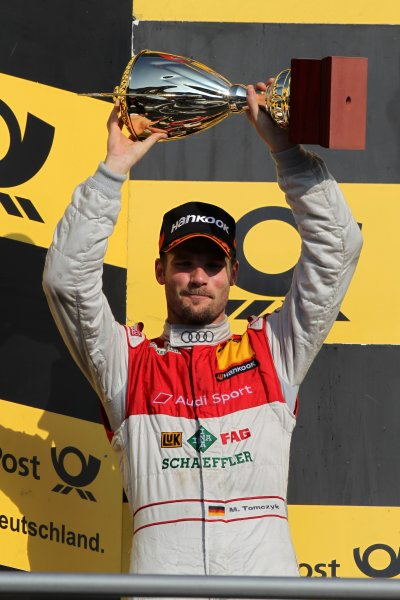 Martin Tomczyk (GER), Audi Sport Team Phoenix  (2nd) celebrates with his trophy on the podium.