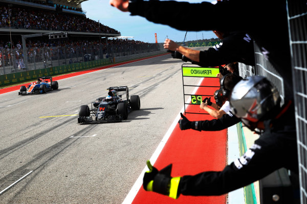 Circuit of the Americas, Austin Texas, USA. Sunday 23 October 2016. Fernando Alonso, McLaren MP4-31 Honda, crosses the line in 5th to the delight of the McLaren team. World Copyright: Steven Tee/LAT Photographic ref: Digital Image _O3I1545