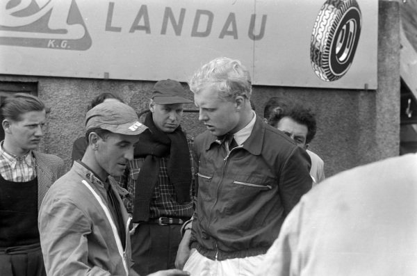 Mike Hawthorn speaks with a mechanic.