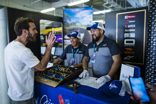 Jean-Eric Vergne (FRA), DS Techeetah talks to the Maui Jim representatives about the sunglasses on their stand in the DS Techeetah garage