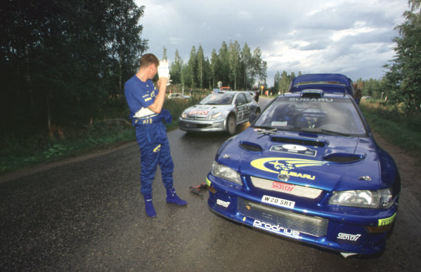 WRC Neste Rally of Finland 2000 17th - 20th August 2000. Rd 9/13. Marcus Gronholm passes Richard Burns on Leg 1 of the Rally. Photo:McKlein/LAT Ref 35mm A10