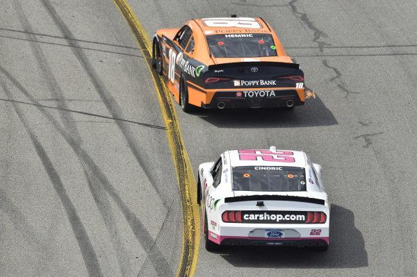 #18: Daniel Hemric, Joe Gibbs Racing, Toyota Supra Poppy Bank, #22: Austin Cindric, Team Penske, Ford Mustang Carshop