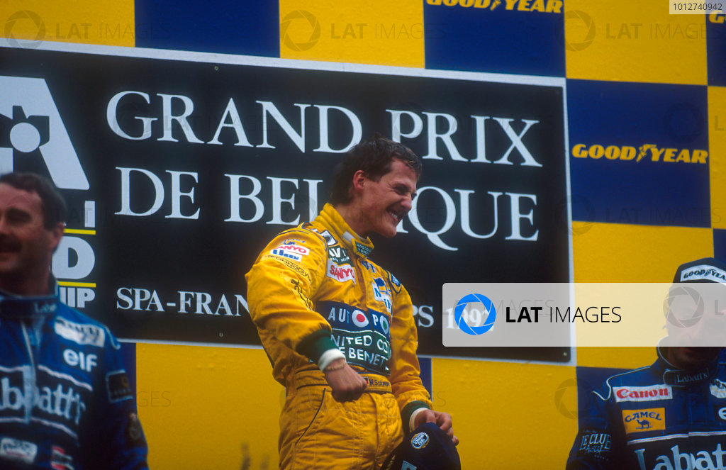 1992 Belgian Grand Prix.Spa-Francorchamps, Belgium.28-30 August 1992.Michael Schumacher (Benetton Ford) celebrates 1st position and his maiden Grand Prix win on the podium. Nigel Mansell, 2nd position and teammate Riccardo Patrese, 3rd position (both Williams Renault) also on the podium.  World Copyright - LAT Photographic
