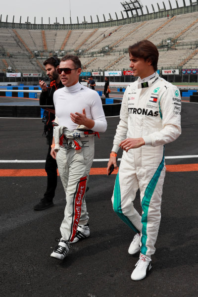 Tom Kristensen (DNK) and Esteban Gutierrez (MEX) walk the track