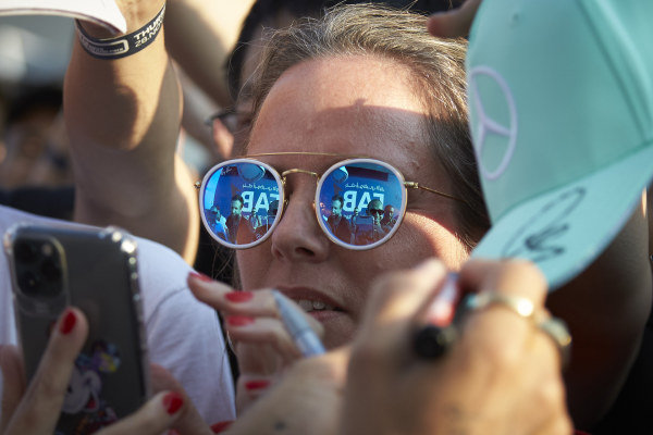 A fan gets a photo of Lewis Hamilton, Mercedes AMG F1