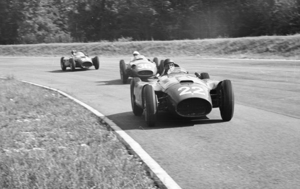 1956 Italian Grand Prix.Monza, Italy. 31/8-2/9 1956.Juan Manuel Fangio (Lancia-Ferrari D50) leads Stirling Moss (Maserati 250F) and Peter Collins (Lancia-Ferrari D50). Fangio later took over Collins' car to clinch his fourth World Championship after his developed technical problems. Moss finished in 1st position.World Copyright - LAT Photographic
